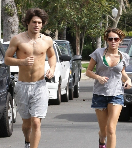 Miley Cyrus jogging with shirtless Justin Gaston